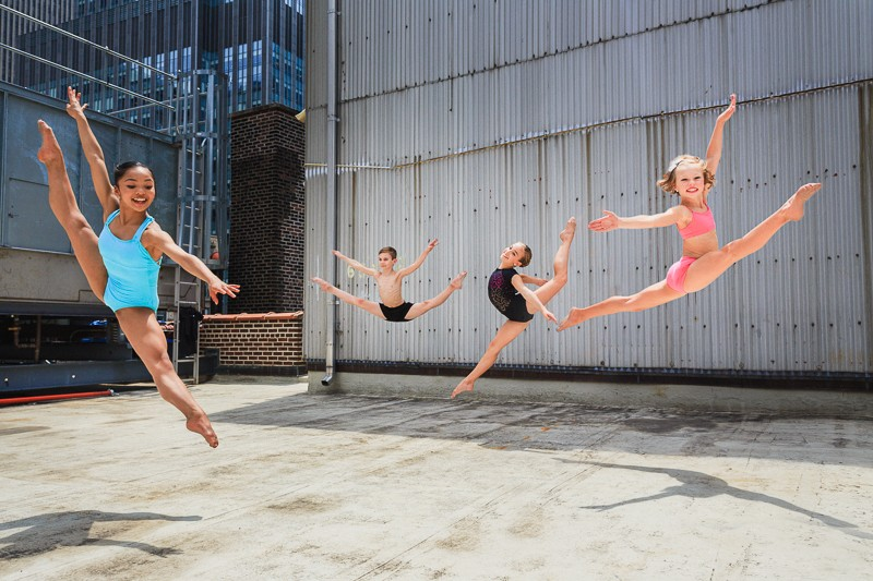 Jasmine Cruz, Brady Farrar, Emma York, and Laci Justice of NYCDA on the rooftop of the Times Square Capezio flagship store