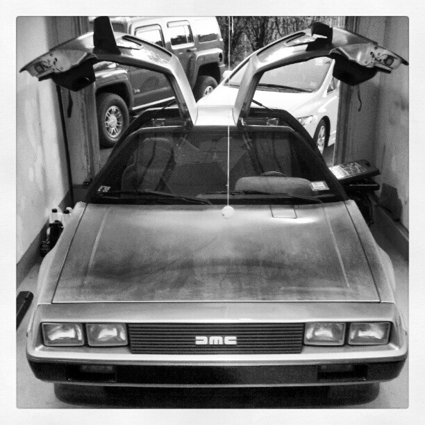 DeLorean in the garage with gullwing doors up