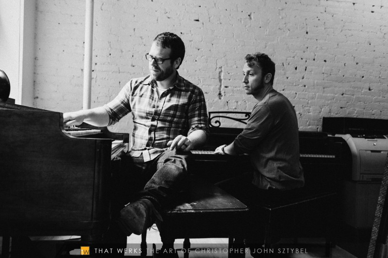 Rich DeCicco (left) and John White (right) playing their organs.