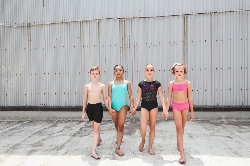 Brady Farrar, Jasmine Cruz, Emma York, Laci Justice of NYCDA on the rooftop of the Times Square Capezio flagship store